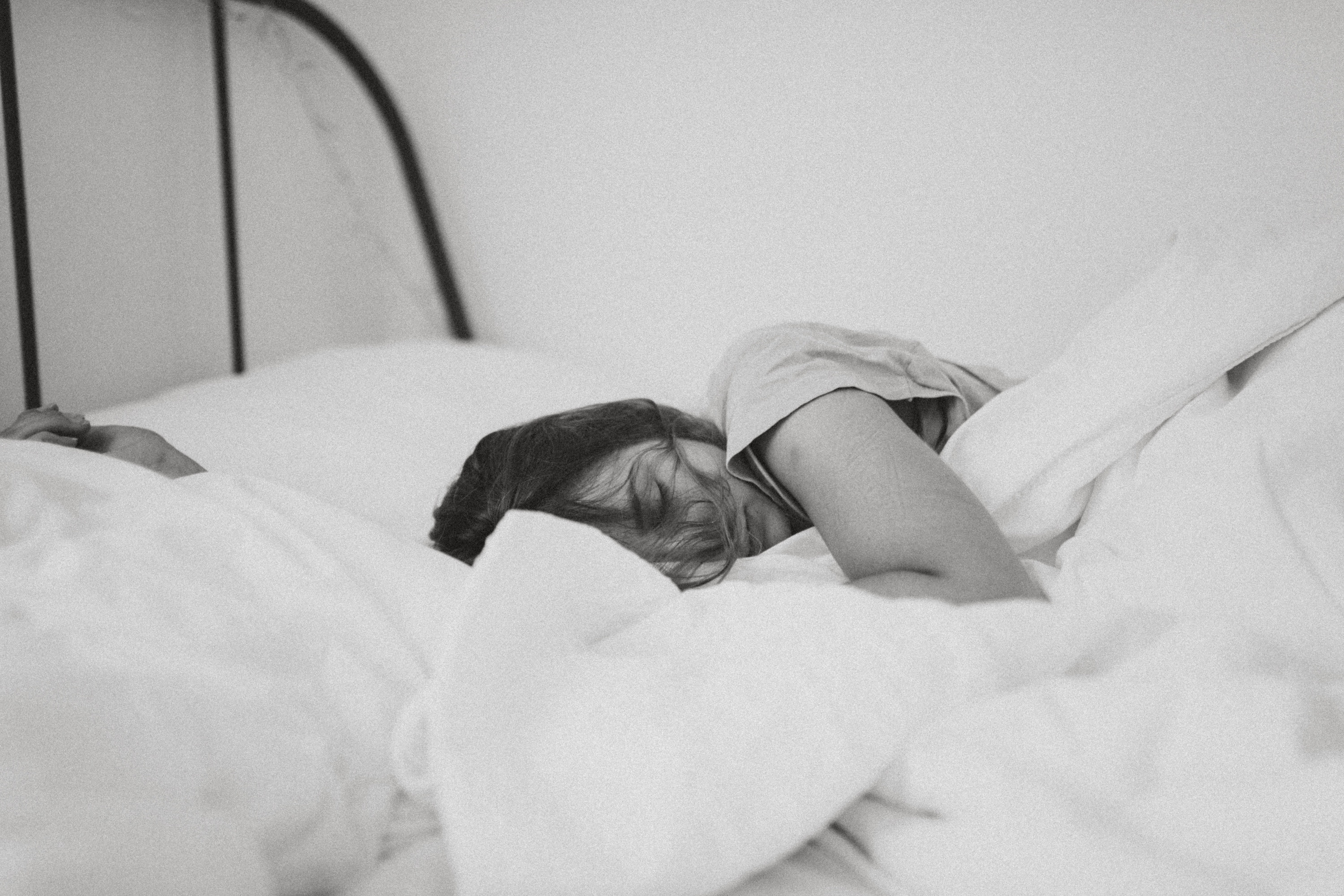 Photo of woman sleeping on a bed.