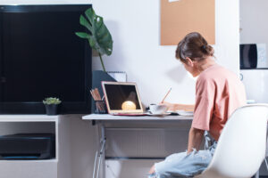 Woman sitting working from home
